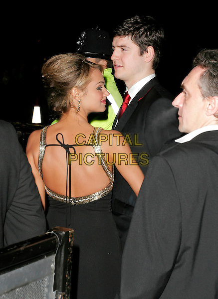 JAMES ALEXANDROU & KARA TOINTON.Leaving The National Television Awards 2006 held at the Royal Albert Hall, London, UK. .October 31st, 2006.Ref: AH.half length black suit dress profile back behind rear.www.capitalpictures.com.sales@capitalpictures.com.©Adam Houghton/Capital Pictures.