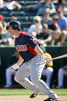 Matt LaPorta #7 of the Cleveland Indians bats against the Oakland Athletics in a spring training game at Phoenix Municipal Stadium on March 2, 2011  in Phoenix, Arizona. .Photo by:  Bill Mitchell/Four Seam Images.