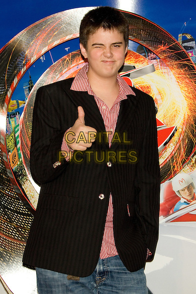 "MILES ROBBINS.2008 Tribeca Film Festival - Premiere of ""Speed Racer"" at the Tribeca Performing Arts Center,  New York, NY, USA,.May 3, 2008..half length black jacket red shirt thumb up.CAP/LNC/TOM.©LNC/Capital Pictures"