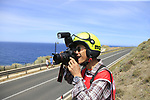 Photographer Yuzuru Sunada at work near Castelsardo along the Costa Smeralda during Stage 1 of the 100th edition of the Giro d'Italia 2017, running 206km from Alghero to Olbia, Sardinia, Italy. 4th May 2017.<br /> Picture: Eoin Clarke | Cyclefile<br /> <br /> <br /> All photos usage must carry mandatory copyright credit (&copy; Cyclefile | Eoin Clarke)<br /> <br /> All photos usage must carry mandatory copyright credit (&copy; Cyclefile | LaPresse)