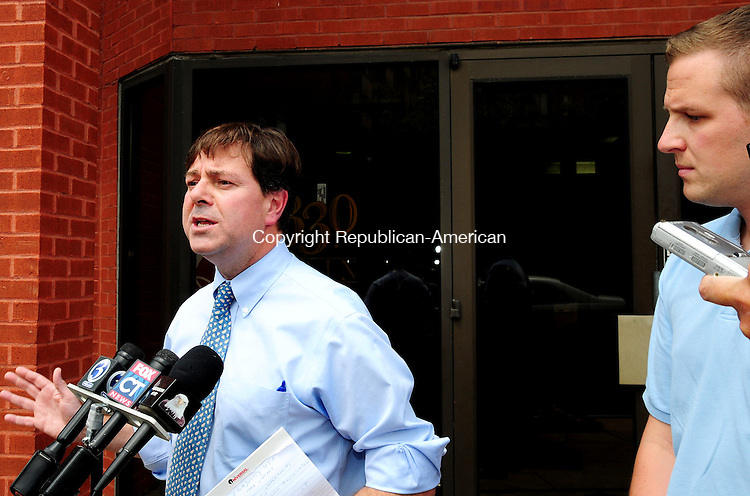 HARTFORD, CT 09 AUG 12 - 10_NEW080912AJ01 - Sen. Andrew W. Roraback, R-Goshen, on Thursday speaks to reporters outside the state Democratic party headquarters in Hartford after discovering a Democratic super PAC is spending $200,000 to try to discredit him just days before the Republican primary. Rep. Sean Williams, R- Watertown, looks on.  Alec Johnson / Republican-American.