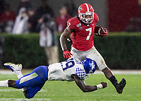 ATHENS, GA - OCTOBER 19: D'Andre Swift #7 of the Georgia Bulldogs is tackled by Yusuf Corker #29 of the Kentucky Wildcats during a game between University of Kentucky Wildcats and University of Georgia Bulldogs at Sanford Stadium on October 19, 2019 in Athens, Georgia.