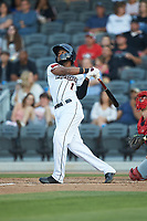 Bryan De La Cruz (1) of the Fayetteville Woodpeckers follows through on his swing against the Salem Red Sox at Segra Stadium on May 15, 2019 in Fayetteville, North Carolina. The Woodpeckers defeated the Red Sox 6-2. (Brian Westerholt/Four Seam Images)