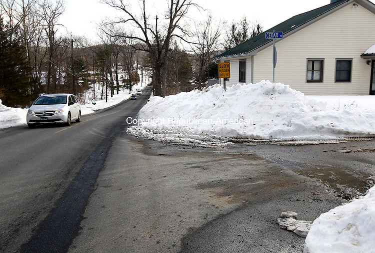 Southbury, CT- 12 February 2013-021213CM01-  The intersection at Old Field Rd and Cedar Trail is cleared after Southbury Public Works crews continued to remove snow and widen streets in Southbury Tuesday.  The workers will be out late Tuesday night into Wednesday morning removing more snow.  According to the Region 15 website, the school district will be in session Wednesday.   Christopher Massa Republican-American
