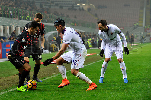 February 19th 2017, San Siro, Milan, Italy; Suso of Milan competes for the ball with Carlos Salcedo of Fiorentina during  Serie A football, AC Milan versus Fiorentina;