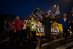 "Some councilmen carry a baton on the ""19th Korrika"", before the down, on a rainy morning, pursued by a crowd of runners. Hondarribia (Basque Country) March 22, 2015. The ""Korrika"" is a relay course, with a wooden baton that passes from hand to hand without interruption, organised every two years in a bid to promote the basque language. The 19th Korrika will run over 11 days and 10 nights, crossing many Basque villages and cities, totalling some 2300 kilometres. Some people consider it an honour to carry the baton with the symbol of the Basques, ""buying"" kilometres to support Basque language teaching. The ""Korrika"" this year ends in Bilbao on March 29. (Gari Garaialde / Bostok Photo)"