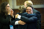 © Joel Goodman - 07973 332324 . 24/06/2016 . Manchester , UK . VOTE LEAVE supporters embrace and cheer after it is announced that Leave are projected to win , at the declaration in the EU referendum at Manchester Town Hall . Photo credit : Joel Goodman