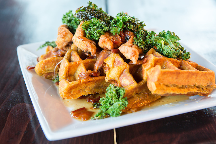 Raleigh, North Carolina - Wednesday January 6, 2016 - Sweet Carolina Chicken and Waffle with sweet potato waffle, crispy chicken strips, pork belly braised kale and maple bacon syrup.