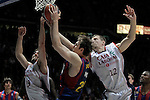 FC Barcelona's Erazem Lorbek (c) and Caja Laboral Baskonia's Fernando San Emeterio (l) and Mirza Teletovic during ACB Finals match. June 15,2010. (ALTERPHOTOS/Acero)