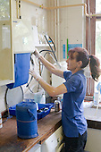 Cleaner replacing roller towels,  State Secondary Roman Catholic school.