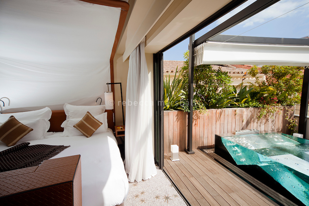 Master bedroom and private terrace with jacuzzi of a suite at the Five Hotel & Spa, Cannes, France, 5 April 2013