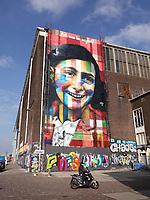 Nederland Amsterdam 24 maart 2018. De Lasloods op het NDSM Terrein. De Braziliaanse streetartist Eduardo Kobra heeft een monumentaal portret van Anne Frank gemaakt op een van de loodsen. In 2018 opent in de Lasloods het grootste street art museum ter wereld. Foto Berlinda van Dam / Hollandse Hoogte