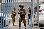 Israeli security forces stand guard at the Qalandia checkpoint, between Jerusalem and Ramallah in the Israeli occupied West Bank, after two Palestinians were shot as they approached security at the border carrying a knife, police said, on April 27, 2016. Photo by Shadi Hatem