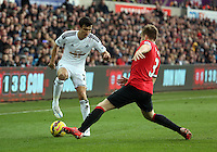 SWANSEA, WALES - FEBRUARY 21: L-R Jack Cork of Swansea avoids a tackle by Luke Shaw of Manchester during the Barclays Premier League match between Swansea City and Manchester United at Liberty Stadium on February 21, 2015 in Swansea, Wales.