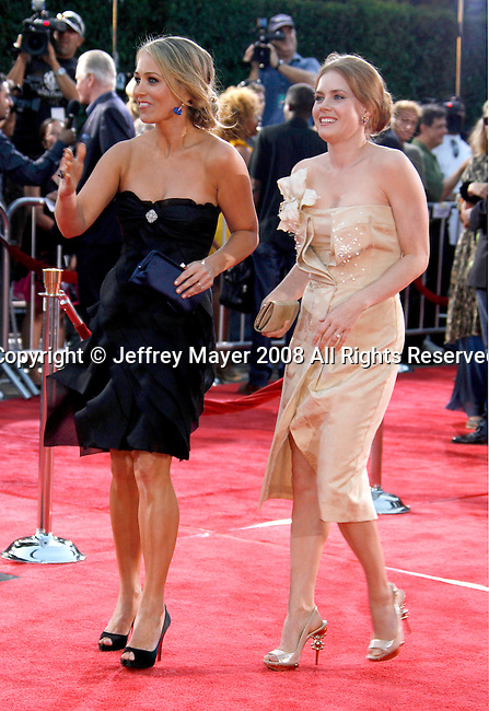 """Actresses Christine Taylor and Amy Adams arrive at the Los Angeles Premiere Of """"Tropic Thunder"""" at the Mann's Village Theater on August 11, 2008 in Los Angeles, California."""