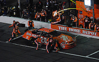 Feb 10, 2007; Daytona, FL, USA; Nascar Nextel Cup driver Tony Stewart (20) pits during the Budweiser Shootout at Daytona International Speedway. Mandatory Credit: Mark J. Rebilas.