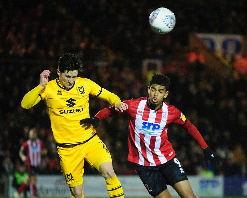 Lincoln City's Tyreece John-Jules vies for possession with Milton Keynes Dons' George Williams<br /> <br /> Photographer Andrew Vaughan/CameraSport<br /> <br /> The EFL Sky Bet League One - Lincoln City v Milton Keynes Dons - Tuesday 11th February 2020 - LNER Stadium - Lincoln<br /> <br /> World Copyright © 2020 CameraSport. All rights reserved. 43 Linden Ave. Countesthorpe. Leicester. England. LE8 5PG - Tel: +44 (0) 116 277 4147 - admin@camerasport.com - www.camerasport.com