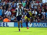Pictured L-R: Jonas Olsson of West Brom pushes away Wayne Routledge of Swansea. Sunday 01 September 2013<br />