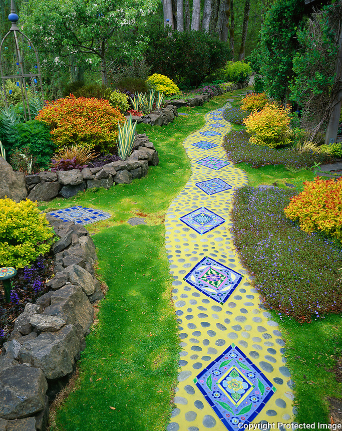 Vashon Island, WA<br /> Whimsical garden of tile artist Clare Dohna featuring moasic tile pathway