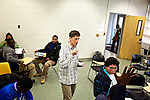Greg Wahl, center, associate professor at Montgomery College, answers questions from students in his Basic Writing II class, as students formed groups to begin work on their final project for class. If students pass this class, it allows them to progress to the college level english program. Otherwise students will face the decision to take the remedial class again or drop out.