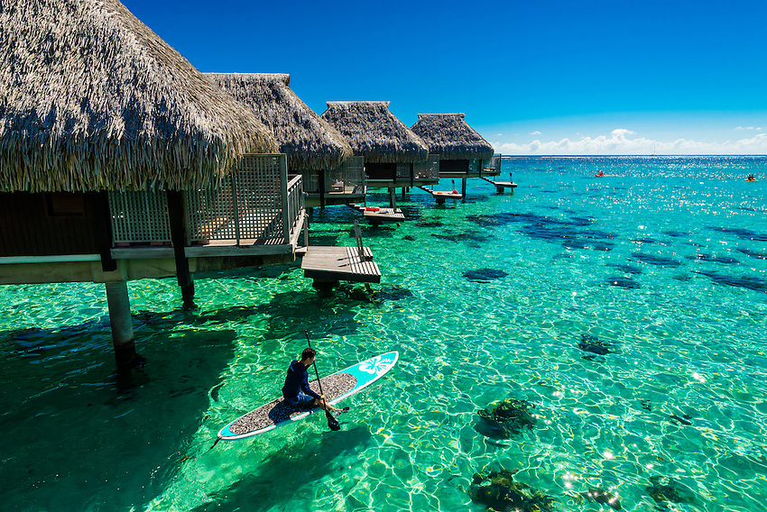 Overwater bungalows in the lagoon (inside the reef), Hilton Moorea Lagoon Resort, island of Moorea, French Polynesia.