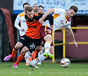 Motherwell's Henri Anier and Motherwell's Fraser Kerr challenge for the ball.