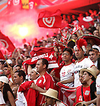 14 June 2006: Flares and flags are used to show support for the Tunisians. Tunisia tied Saudi Arabia 2-2 at the Allianz Arena in Munich, Germany in match 16, a Group H first round game, of the 2006 FIFA World Cup.