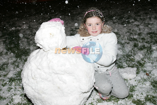 children enjoy the snow as it covered the ground with about an inch in some parts of South Louth and East Meath. Michelle McKenna starting to make there snow man in Millmount abbey in Drogheda...Photo: Newsfile/Fran Caffrey.