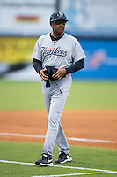 Pulaski Yankees manager Tony Franklin (18) coaches third base during te Appalachian League game against the Danville Braves at Legion Field on August 7, 2015 in Danville, Virginia.  The Yankees defeated the Braves 3-2. (Brian Westerholt/Four Seam Images)