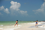 2 girls run out of the surf of SIlver Spur Beach, Bahia Honda ST Pk, Florida Keys