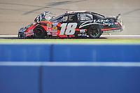 Oct. 10, 2009; Fontana, CA, USA; NASCAR Nationwide Series driver Denny Hamlin (18) after crashing during the Copart 300 at Auto Club Speedway. Mandatory Credit: Mark J. Rebilas-
