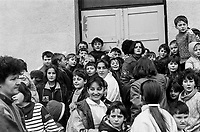 People living at the Varazdin refugee camp in the winter of 1992. The boy in the middle waving, is 'Elvis'. <br /> <br /> In 1992 while volunteering at the Varazdin refugee camp Panos photographer Bjoern Steinz met and became close to Elvis, a Bosnian Muslim refugee, and his family. They shared the hardships of camp life together which Steinz documented. While the prints were archived for many years two of the images always returned to Bjoern's thoughts. 25 years later he set out to try and find out what had happened to Elvis and his family in the intervening years. Modern social media made the task surprisingly easy and they were reunited in Hadzici where Elvis now lives with his family.