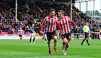Lincoln City's Tom Pett, left, celebrates scoring the opening goal with team-mate Harry Toffolo<br /> <br /> Photographer Chris Vaughan/CameraSport<br /> <br /> The EFL Sky Bet League Two - Lincoln City v Crewe Alexandra - Saturday 6th October 2018 - Sincil Bank - Lincoln<br /> <br /> World Copyright &copy; 2018 CameraSport. All rights reserved. 43 Linden Ave. Countesthorpe. Leicester. England. LE8 5PG - Tel: +44 (0) 116 277 4147 - admin@camerasport.com - www.camerasport.com