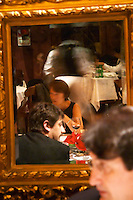 Mirror reflection of guests at the dining table, mirror in heavy ornamented gild frame The Oviedo Restaurant, Buenos Aires Argentina, South America