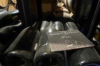 old bottles in the cellar meursault goutte d'or premier cru 1997 chalk board dom coche bizouard meursault cote de beaune burgundy france