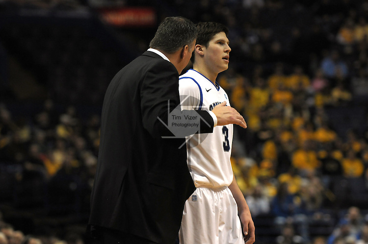 Creighton Bluejays forward Doug McDermott (3) listens to Creighton Bluejays head coach Greg McDermott -- who is also his father -- in the first quarterfinal game of the Missouri Valley Conference Tournament. The Creighton University Bluejays defeated the Drake Bulldogs 65-53 on Friday March 8, 2013 at the Scottrade Center in St. Louis, Missouri.
