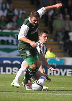 Kenny McLean tackles Gary Deegan in the St Mirren v Hibernian Clydesdale Bank Scottish Premier League match played at St Mirren Park, Paisley on 18.8.12.