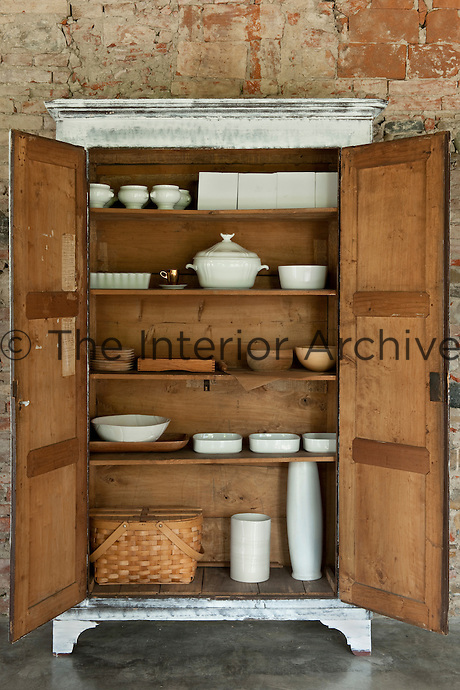 Every corner of La Chiesuola bears witness to the discriminating eye of its owner, including the interior of this cupboard with its collection of bowls, tureens and vases