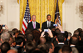United States President Barack Obama makes remarks at the LGBT Pride Month celebration in the East Room at the White House on June 13, 2013.  U.S. Vice President Joe Biden stands at left.<br /> Credit: Molly Riley / Pool via CNP