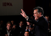 MITT ROMNEY waves to supporters at a rally following the Iowa caucus Tuesday, January 3, 2012 in Des Moines, Iowa.