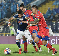 BOGOTA - COLOMBIA, 10-04-2018: Ayron del Valle (Izq) jugador de Millonarios disputa el balón con Carlos Giraldo (C) y Jonathan Lopera (Der) jugadores de Deportivo Pasto durante partido por la fecha 14 de la Liga Águila I 2018 jugado en el estadio Nemesio Camacho El Campin de la ciudad de Bogotá. / Ayron del Valle (L) player of Millonarios fights for the ball with Carlos Giraldo (C) and Jonathan Lopera (R) player of Deportivo Pasto during the match for the date 14 of the Liga Aguila I 2018 played at the Nemesio Camacho El Campin Stadium in Bogota city. Photo: VizzorImage / Gabriel Aponte / Staff.