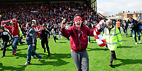 Lincoln City fans run on the pitch at the end of the game<br /> <br /> Photographer Chris Vaughan/CameraSport<br /> <br /> Vanarama National League - Lincoln City v Macclesfield Town - Saturday 22nd April 2017 - Sincil Bank - Lincoln<br /> <br /> World Copyright &copy; 2017 CameraSport. All rights reserved. 43 Linden Ave. Countesthorpe. Leicester. England. LE8 5PG - Tel: +44 (0) 116 277 4147 - admin@camerasport.com - www.camerasport.com