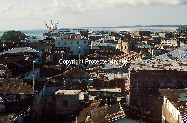 COTANZA35039.Country. Tanzania. Zanzibar. View of the roofs of buildings and buildings. Ship in background. View..©Per-Anders Pettersson/iAfrika Photos