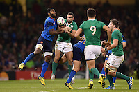 Noa Nakaitaci of France and Dave Kearney of Ireland compete for the ball. Rugby World Cup Pool D match between France and Ireland on October 11, 2015 at the Millennium Stadium in Cardiff, Wales. Photo by: Patrick Khachfe / Onside Images