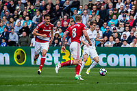 Sunday April 02 2017 <br /> Pictured: Tom Caroll of Swansea City  in action <br /> Re: Premier League match between Swansea City and Middlesbrough at The Liberty Stadium, Swansea, Wales, UK. SUnday 02 April 2017