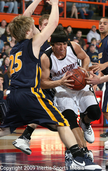 RAPID CITY, SD - MARCH 19, 2009 --  Julian Defender #20 of McLaughlin drives hard into Tyler Christensen #25 of Sioux Valley during their consolation bracket game at the 2009 S.D. State A Boys Basketball tournament at the Rushmore Plaza Civic Center in Rapid City. (Photo by Dick Carlson/Inertia)