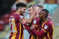Charlie Wyke of Bradford City is congratulated by team mates after coring the second goal for Bradford City during the Sky Bet League 1 match between Bradford City and Rochdale at the Northern Commercial Stadium, Bradford, England on 9 December 2017. Photo by Thomas Gadd.