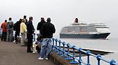 Cunard's Queen Victoria sails up the Clyde on its first ever port of call in Scotland, when it arrived at Greenock today (Wed). The 90,000 tonne vessel docked at The Ocean Terminal on Wednesday, part of an eleven day UK wide tour the luxury liner will make on its maiden voyage. It will take in Dublin, Belfast, Cobh and Liverpool, among other ports, on its way - Picture by Donald MacLeod 28.07.10 - mobile 07702 319 738 - clanmacleod@btinternet.com