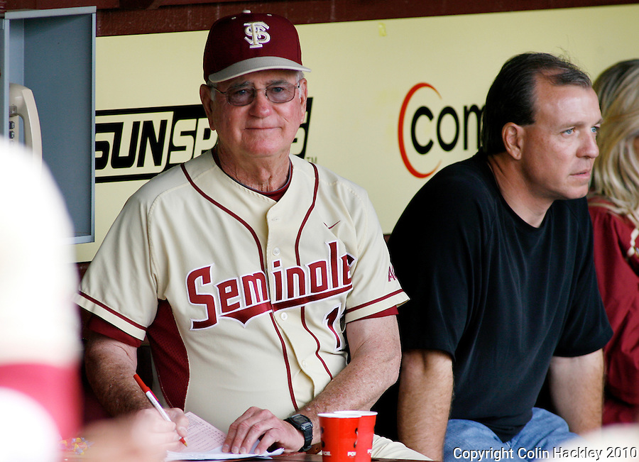 TALLAHASSEE, FL 3/28/10-FSU-MARY BASE10 CH-Florida State Head Baseball Coach Mike Martin, left, monitors the game against Maryland as Head Football Coach Jimbo Fisher, joins him the dug out Sunday at the Dick Howser Stadium in Tallahassee. The Seminoles beat the Terrapins 9-5...COLIN HACKLEY PHOTO