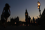 The sun sets on Big Ben and the Houses of Parliament on the river Thames in London .22nd July 2012. Photo Steve Christo.
